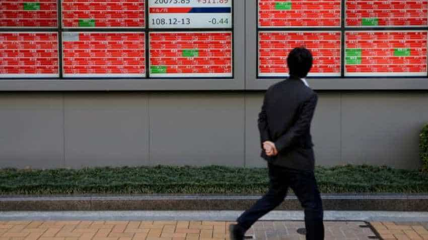 Global Markets: Asian stocks fail to catch Wall Street's Fed-fuelled rally