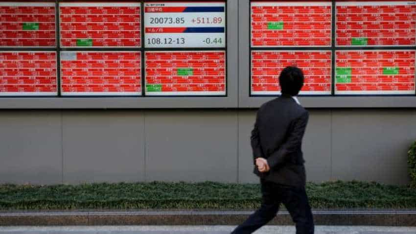 Global Markets: Asia shares dip, dollar gains on weak sterling