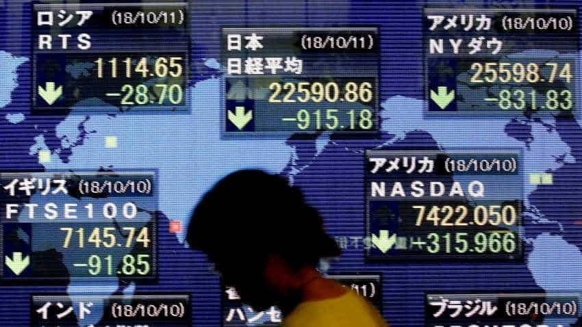 Asian shares nudge higher on stimulus hopes in major economies as recession fears ease