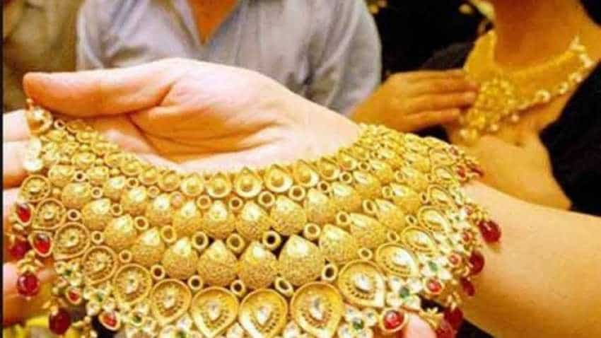Gold price eases as investors book profits, dollar strengthens