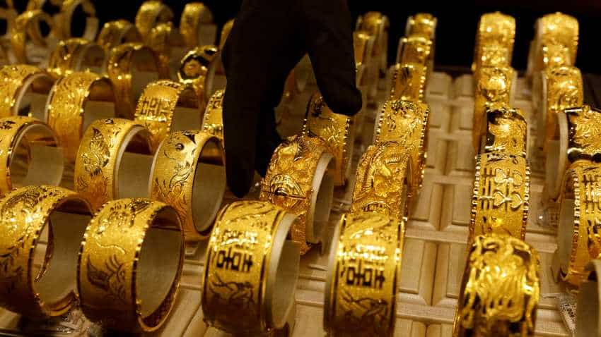 Gold price eases after soaring record high of Rs 40,000 mark amid recession fears