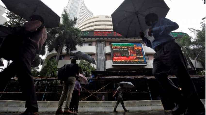 Sensex, Nifty trade cautiously ahead of state assembly poll results; Maruti Suzuki, Indian Bank stocks gain