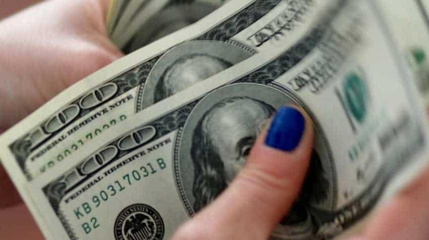 US dollar rises as risk appetite improves