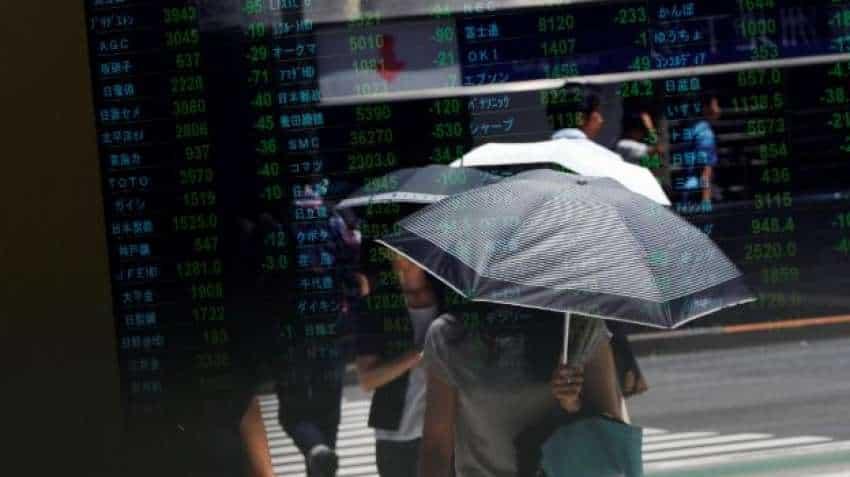 Global Markets: Asian stocks nudge up as virus spread slows, euro fragile