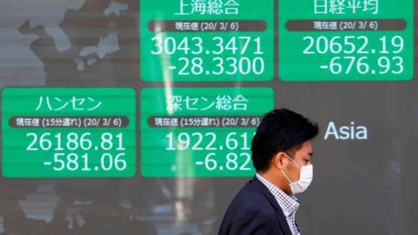 Global Markets: Asian stocks tumble as Trump warns of horrors to come