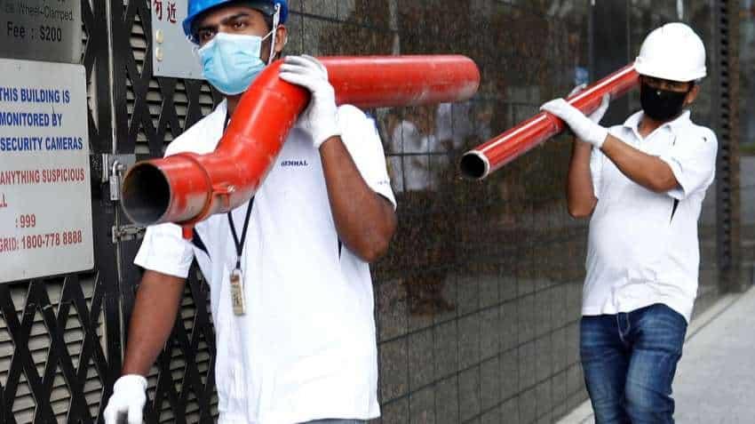 Singapore quarantines migrant workers in virus fight