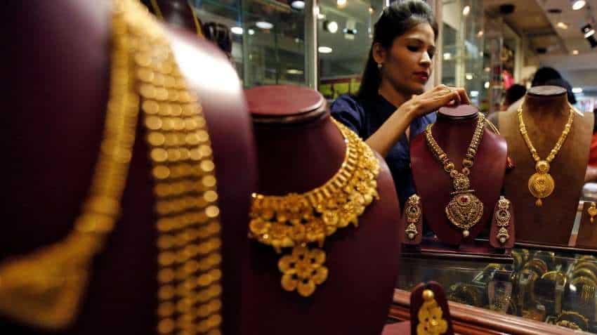 Gold price slips as lockdown easing plans lift risk appetite