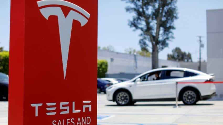 Elon Musk reopens Tesla factory, says come and arrest me