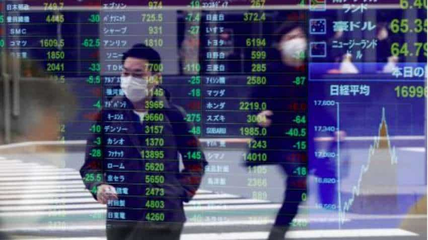 Global Markets: Asian shares slip after mixed Wall Street session