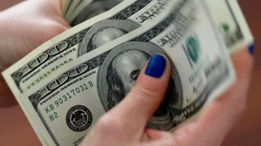 US dollar climbs amid economic data