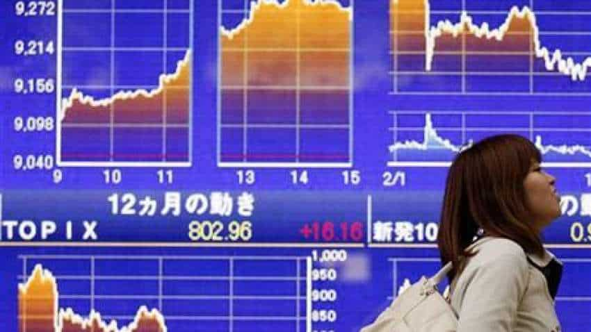 Asian equities slip as vaccine trials, stimulus talks stall