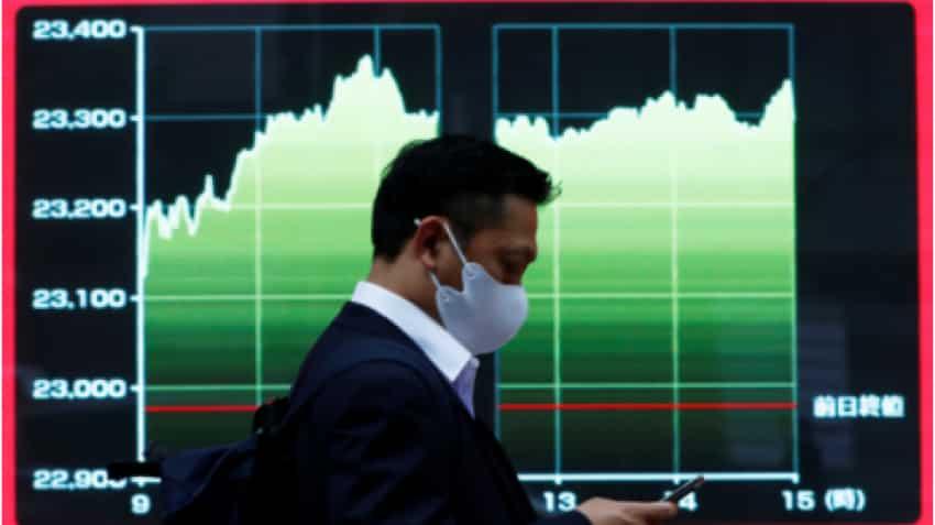 Asian shares mixed, U.S. dollar near 2-1/2 year lows