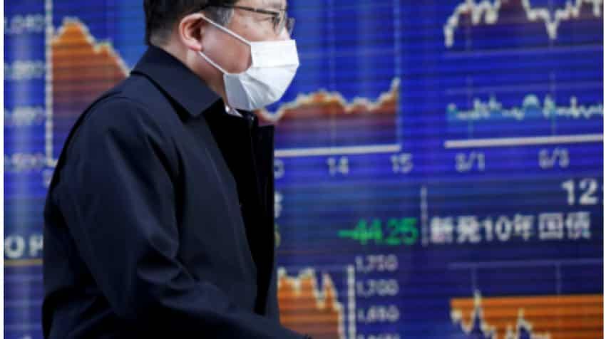 Asian shares slip from all-time highs; oil falls on virus case surge