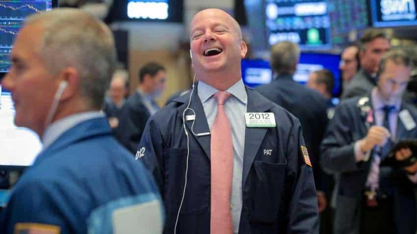 Wall Street climbs on boost from tech stocks