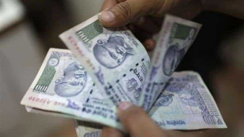 Rupee gains on dollars inflows; traders await auction outcome
